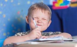 Preschool boy learning to write education pen kid Stock Photo