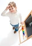Preschool boy near blackboard Stock Photo