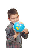 Preschool boy playing with a globe Royalty Free Stock Image