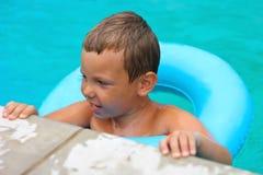 Preschool boy swims in pool Royalty Free Stock Images