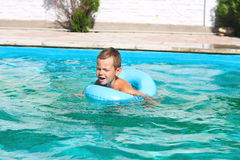 Preschool boy swims in pool Royalty Free Stock Photos