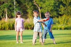 Preschool boy throwing frisbie Stock Images