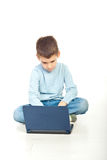 Preschool boy using notebook Stock Image