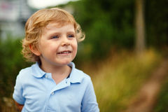 Preschool boy walking on a country road Stock Photos