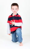 Preschool boy on white background. Preschool boy holding up 5 fingers for his age on white background Royalty Free Stock Images