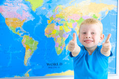 Preschool boy with world map, thumbs up Royalty Free Stock Image