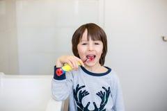 Preschool boys, brushing their teeth in bathroom Royalty Free Stock Photography