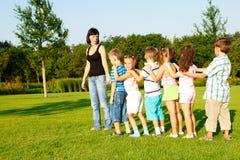 Preschool boys and girls with teacher stock photography