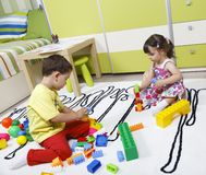 Preschool build castles with plastic cubes Stock Image