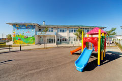 Preschool building. Exterior with playground on a sunny day stock photo