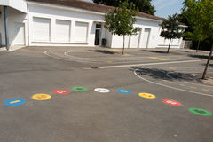 Preschool building exterior with playground on a sunny day Stock Images
