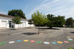 Preschool building exterior with playground on a sunny day Royalty Free Stock Photography