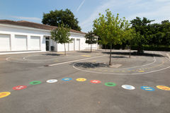 Preschool building exterior with playground on a sunny day Stock Photography