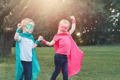 Preschool Caucasian children playing superheroes stock photos