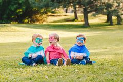 Preschool Caucasian children playing superheroes royalty free stock image