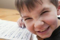Preschool chłopiec writing imię fotografia royalty free