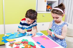 Preschool child create a picture with foam shapes Stock Photography