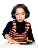 Preschool child with headphones and plate Royalty Free Stock Photos