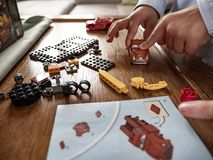 Preschool child is playing with lego bricks royalty free stock image