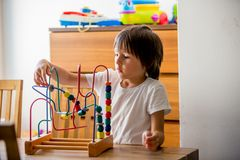 Preschool child, playing with toys in a sunny room Stock Photo