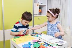 Preschool child working for homework received from kindergarten Royalty Free Stock Photos
