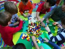 Preschool children at activities. In kindergarten - playing lego stock photography