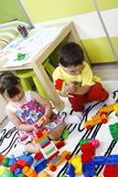 Preschool children build castles with plastic cubes Royalty Free Stock Images