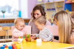 Preschool children in the classroom with the teacher. Preschool children in the classroom with kindergarten teacher royalty free stock image