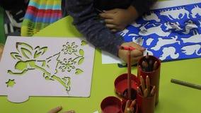 Preschool children drawing stock footage
