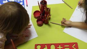 Preschool children drawing stock video footage