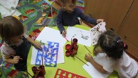 Preschool children drawing stock video