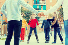 Preschool children playing forcing the city gates Stock Images