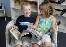 Preschool children read books