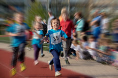 Preschool children run on the marathon road. In a competition stock photography