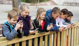 Preschool children with smartphones Stock Photography