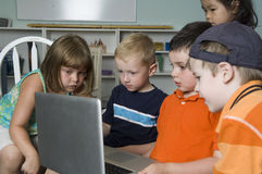 Preschool children using computer Stock Photo