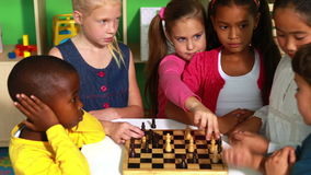 Preschool class learning how to play chess stock video footage