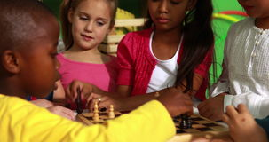 Preschool class learning how to play chess stock video