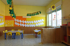 Preschool classroom with chairs and table with drawings Royalty Free Stock Images