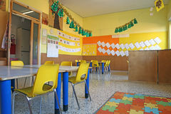 Preschool classroom with chairs and table. Preschool classroom with yellow chairs and table royalty free stock photography