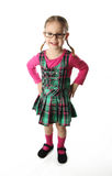 Preschool Girl. Cute preschool age girl wearing glasses and a plaid schoolgirl dress Royalty Free Stock Images