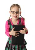 Preschool girl. Cute preschool age girl wearing eyeglasses carrying a stack of heavy books Stock Images
