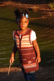 Preschool girl. Here is a beautiful black child wearing a pretty fall sweater standing by a pond Stock Photo