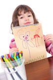 Preschool girl with art. Preschool girl holding up her drawing. Isolated on white Royalty Free Stock Photography