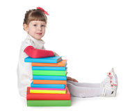 Preschool girl with books stock photo