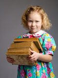 Preschool girl carrying books Stock Photography