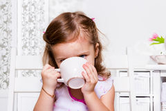 Preschool girl with a cup Stock Photos
