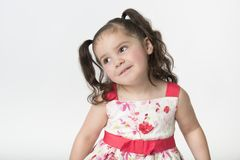 Preschool girl with cute expression looking away stock photo