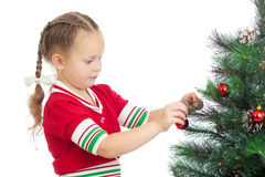 Preschool girl decorating Christmas tree isolated Royalty Free Stock Images