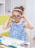 A preschool girl done homework received from kindergarten Stock Photo